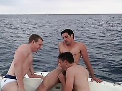 three handsome gay boys fuck on a boat