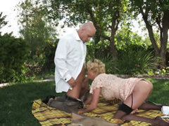 Fine blonde slut in stockings gets nailed outdoors