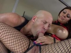 Hot blooded brunette Tori Avano in black fishnet stockings shows