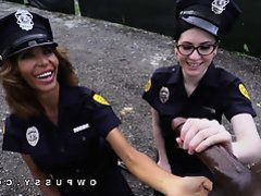 Two female police strip a black man