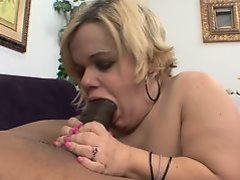 Buxom blonde midget Stella sucking and stroking a massive black pole