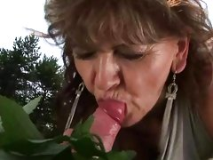 Granny enjoying sex with a boy outdoor