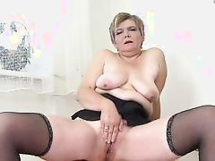 adult masturbates with ebon sex-toy