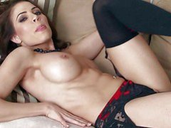Erika Jordan is a massive boobed seductress in swarthy nylons.